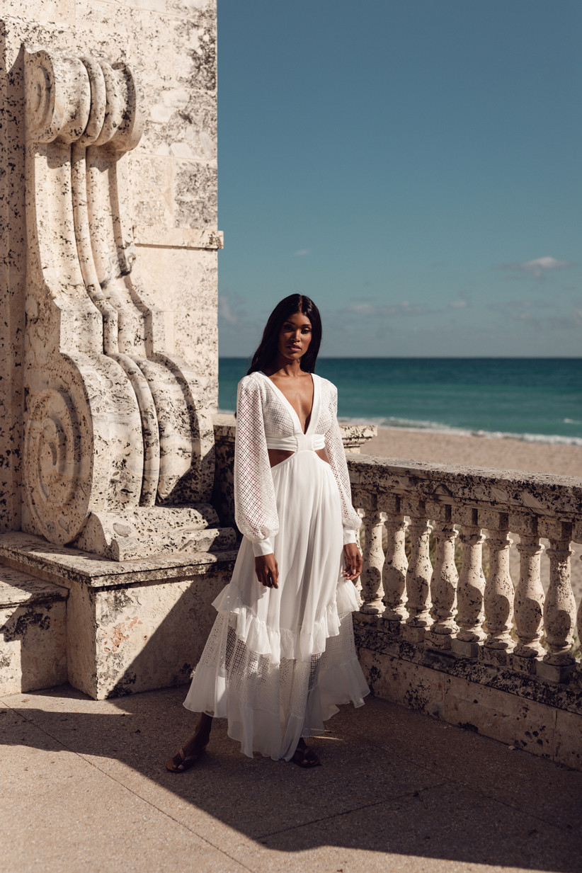 boho wedding dress with flowy sleeves, side cutout and low v neck
