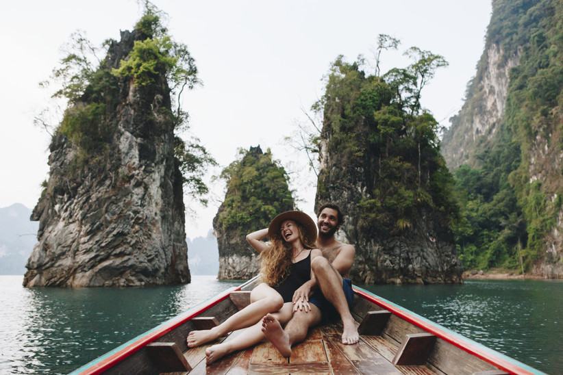 couple sitting on a boat with scenic surroundings