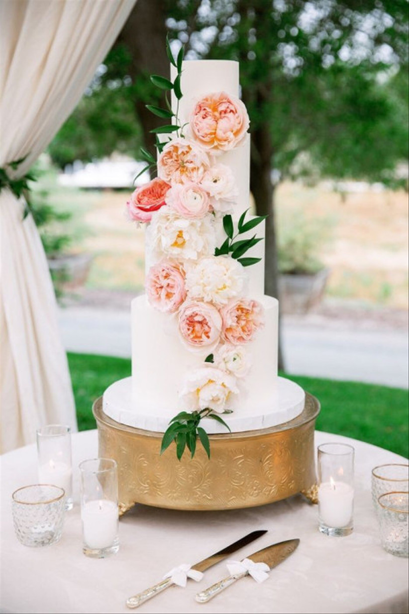 fondant wedding cake decorated with large peonies and roses