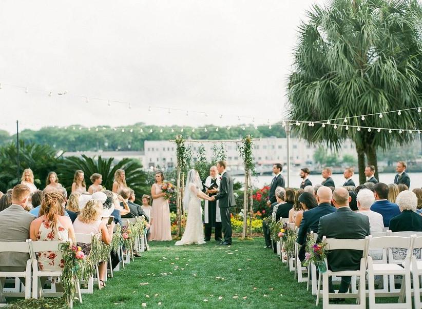 couple stand at the altar at the westin savannah harbor