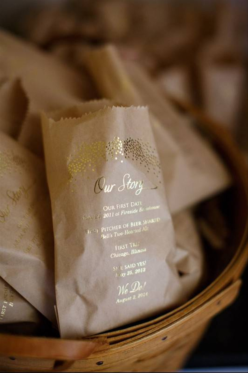 mini paper bags filled with confetti and decorated with