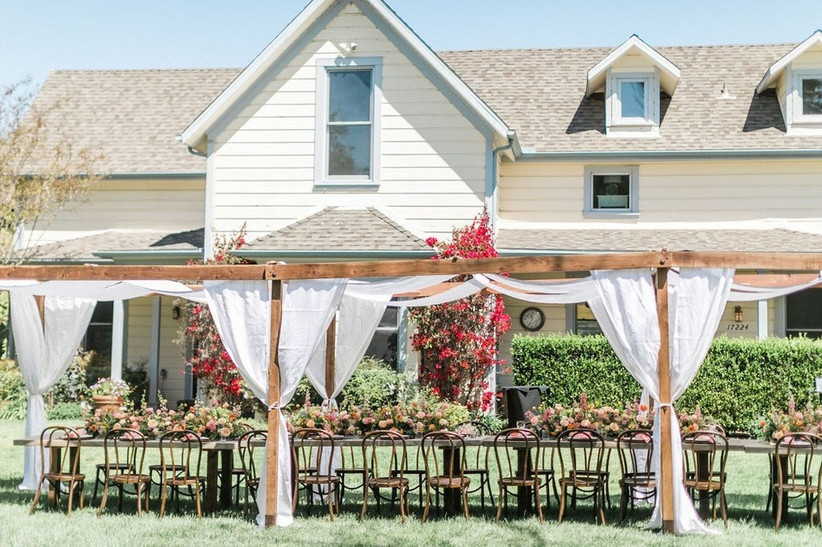 backyard wedding reception canopy tent with long table