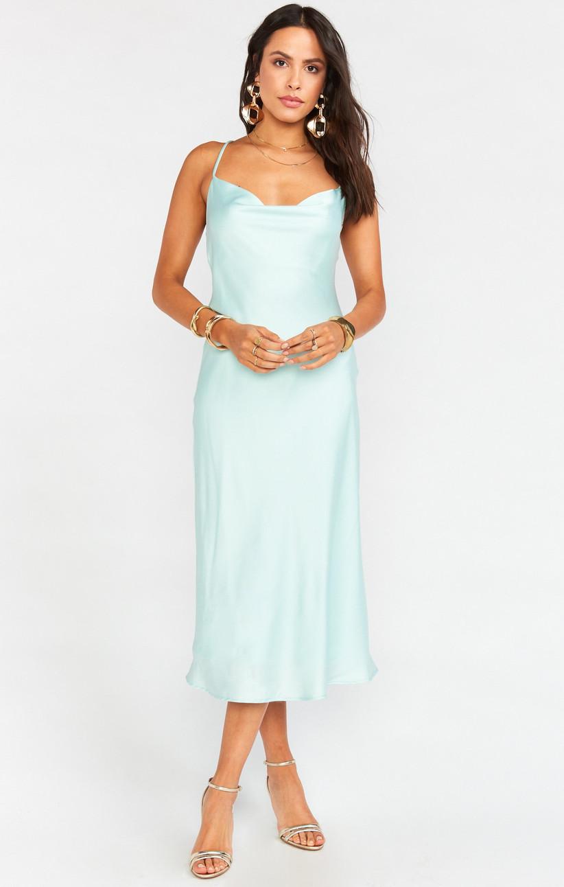Model wearing pastel blue satin midi slip dress