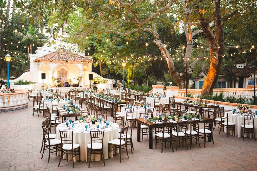 outdoor wedding reception on terrace decorated with string lights