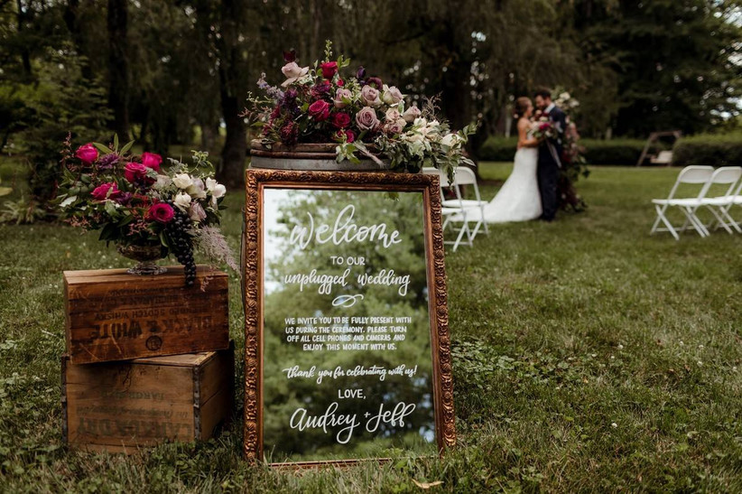 wedding ceremony with unplugged wedding mirror sign