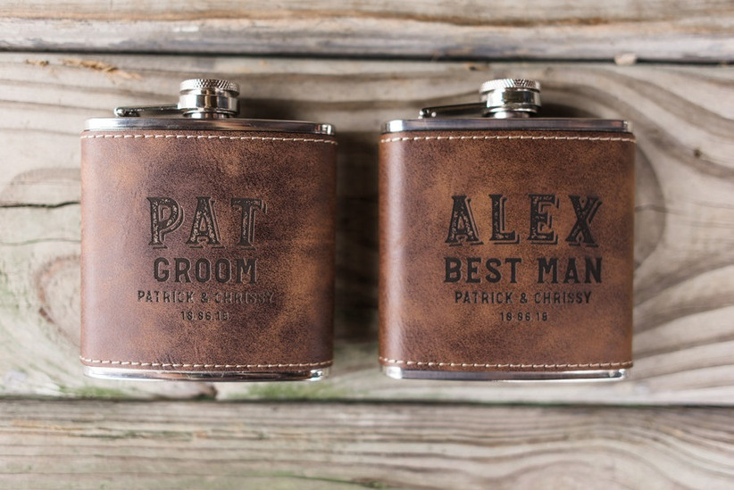 Two leather covered hip flasks engraved with Groom and Best Man