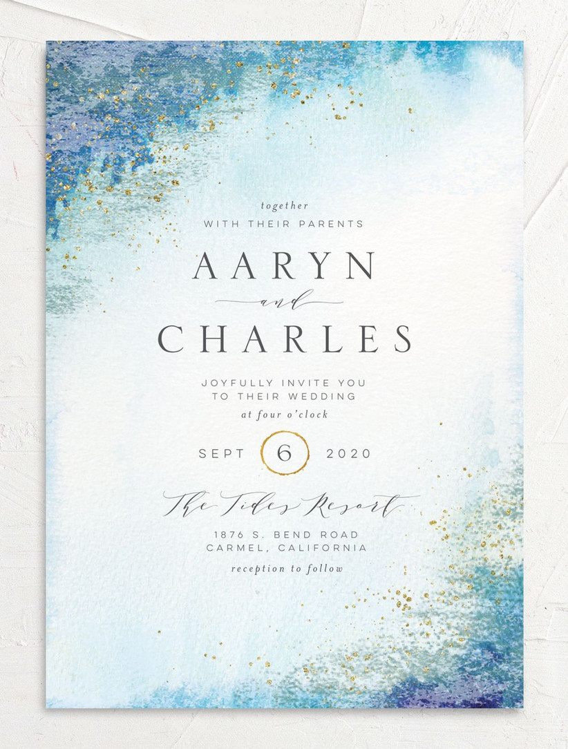 watercolor summer wedding invitation with blue ombre border and metallic gold specks