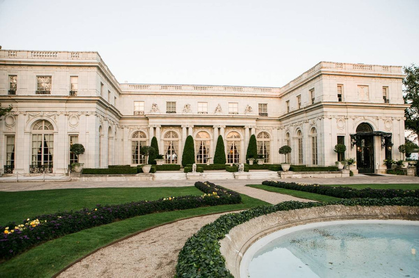 european-style rhode island wedding venue mansion with stone fountain and landscaped gardens in front