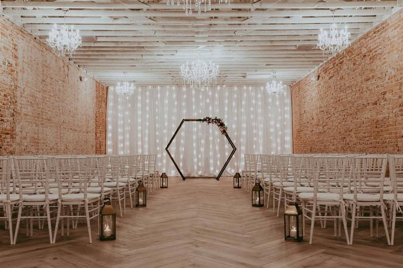indoor industrial event space set up for wedding ceremony