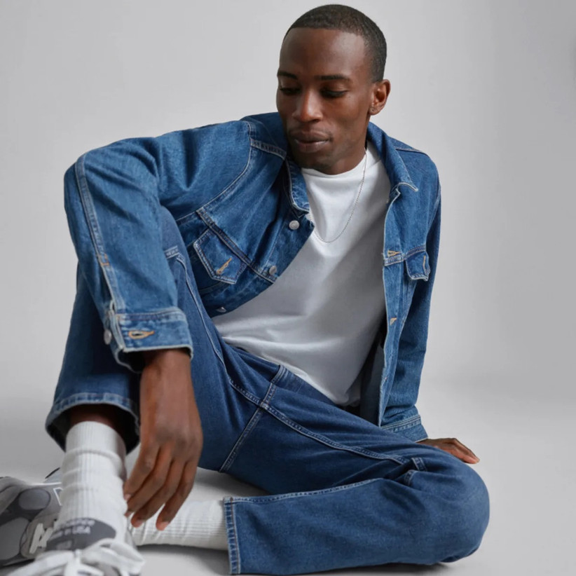 Model wearing trendy blue jean jacket with a white tee and blue jeans