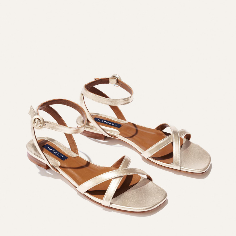 pale gold sandals with criss-cross straps and ankle straps