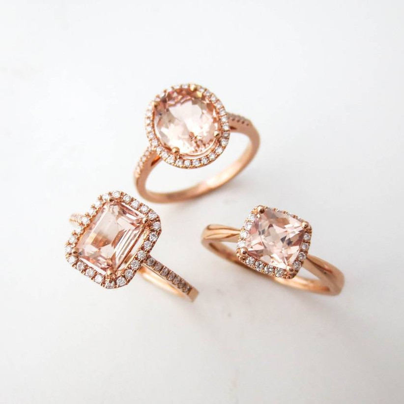 trio of morganite engagement rings against a white background