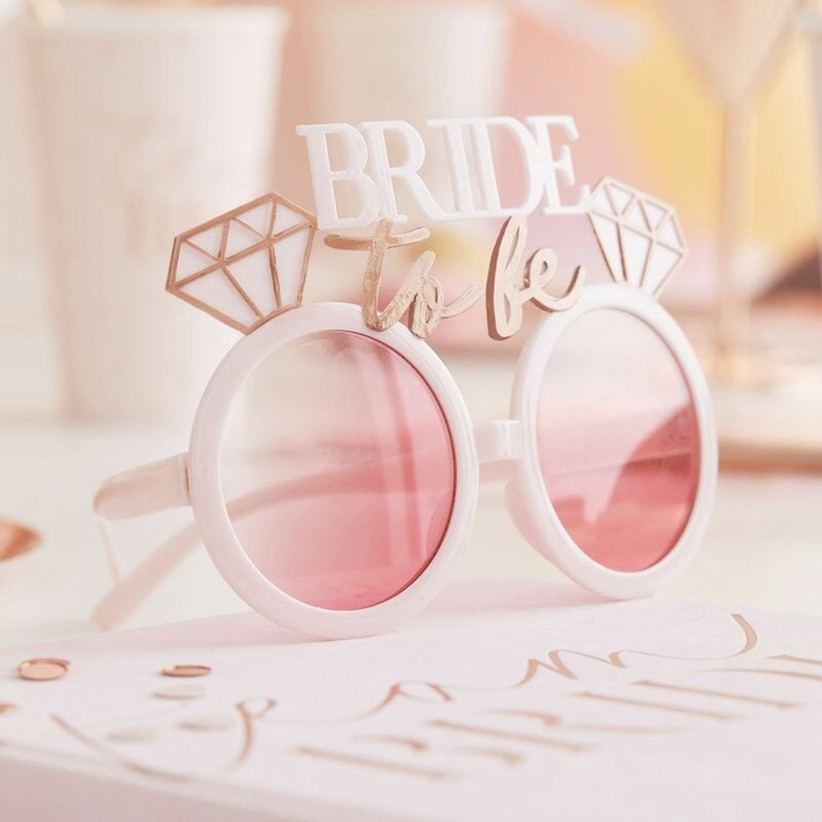 round sunglasses with plastic diamonds and bride-to-be on top