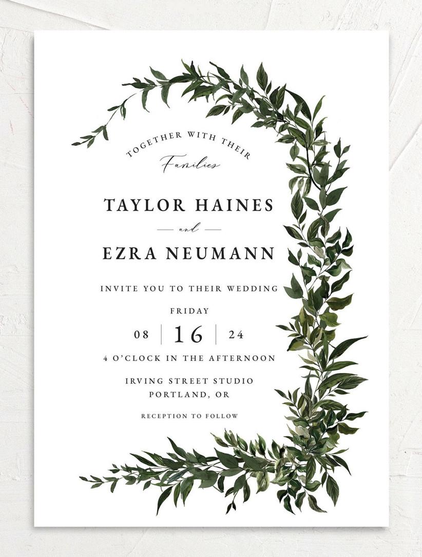 elegant fall wedding invitation white background with greenery vine border and calligraphy font