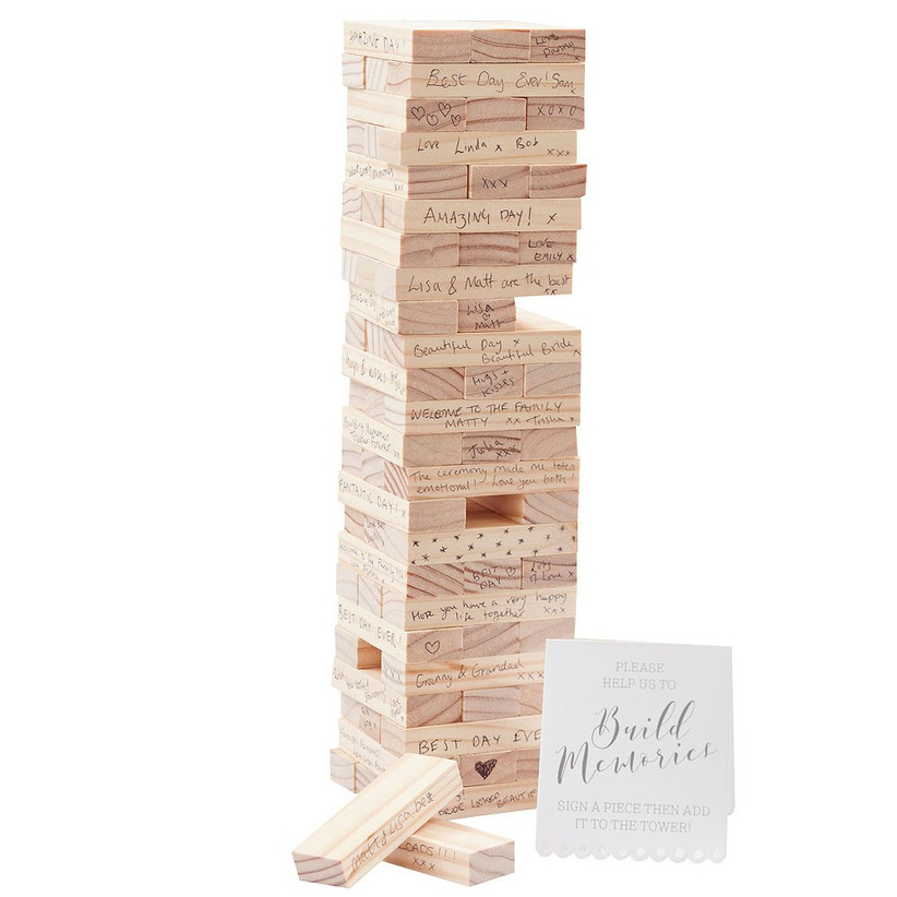Tumbling tower blocks signed by guests unique wedding guest book idea