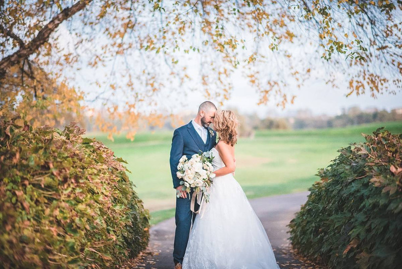 couple under fall tree