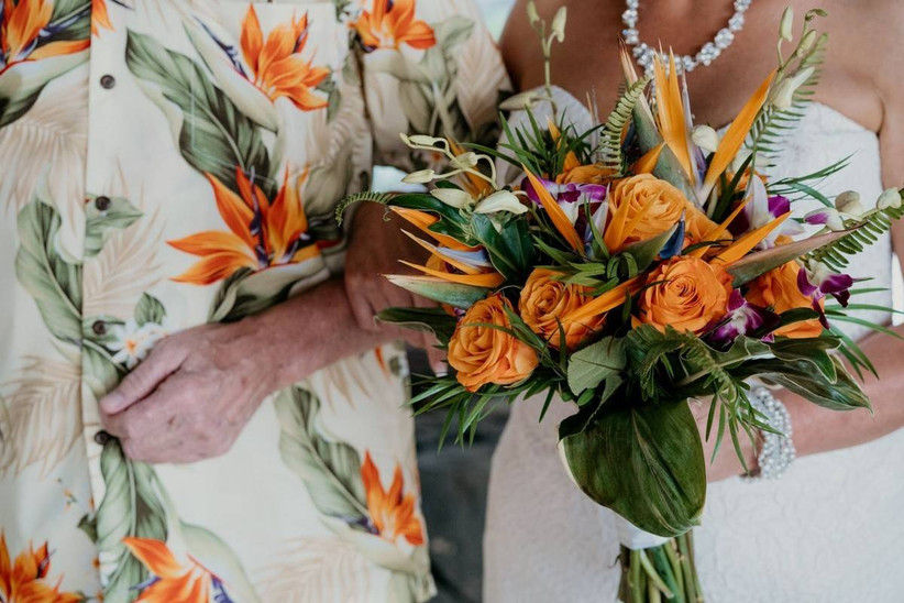 close-up of tropical beach wedding bouquet including Birds of Paradise and orange roses