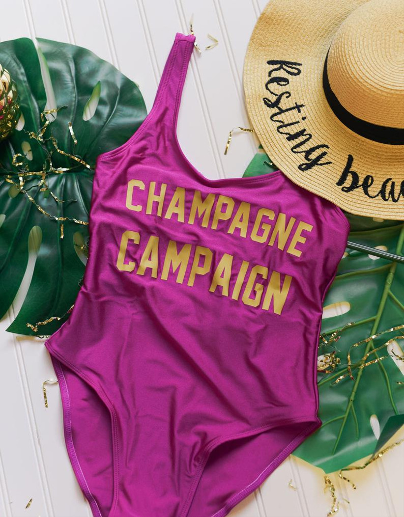 purple one-piece swimsuit is decorated with