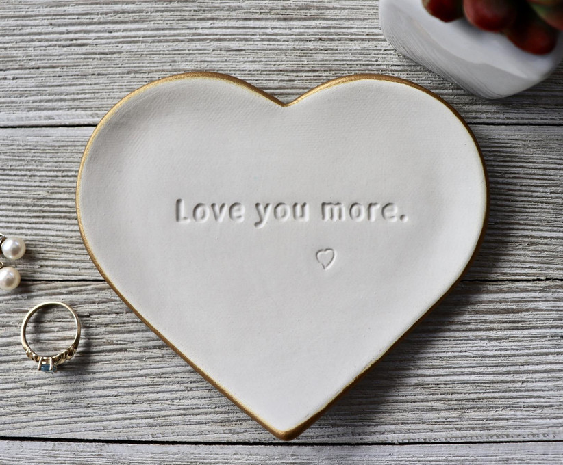 White heart-shaped trinket dish stamped with Love You More