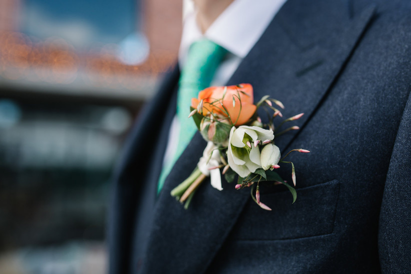 wedding boutonniere with jasmine vines