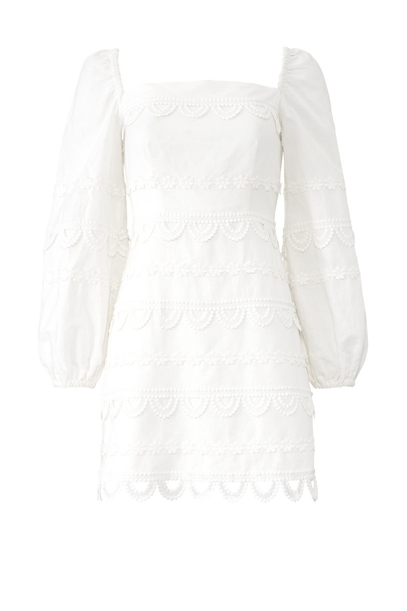 short white engagement party dress with puff sleeves and crochet lace trim