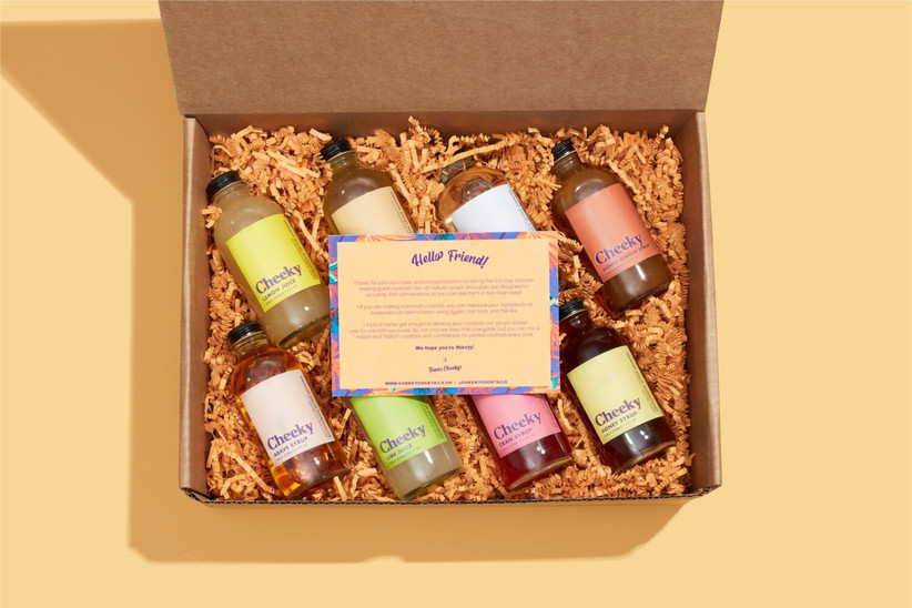 Cheeky Cocktails gift box with eight bottles of syrups and juices drinking gift for couples