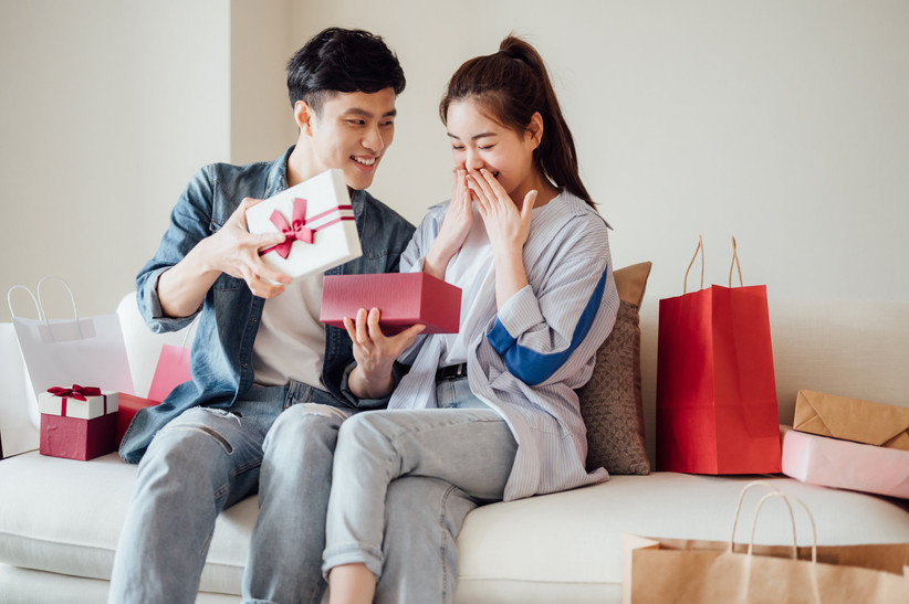 man presenting woman with gift