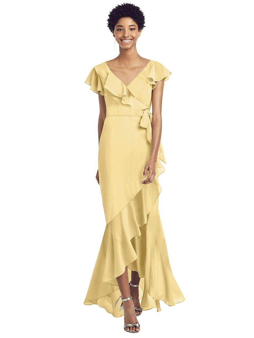 Model wearing pastel yellow bridesmaid dress with ruffles and tied waistline