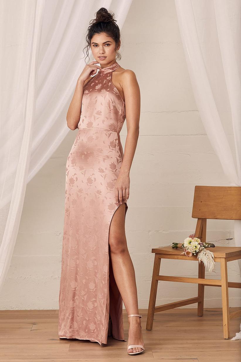 Model wearing sleek halter-neck satin bridesmaid dress with subtle floral embossing