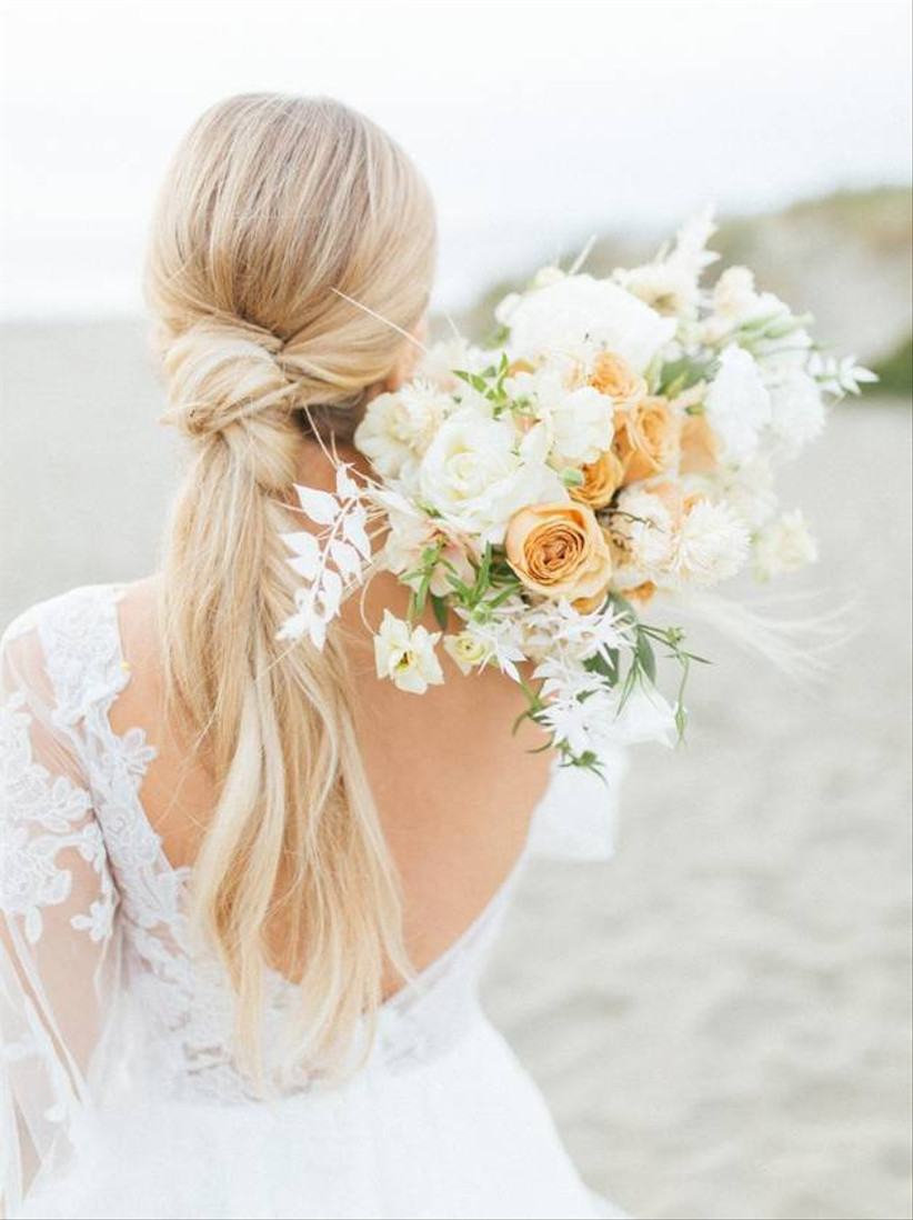 simple beach wedding bouquet with pale orange roses and bleached greenery