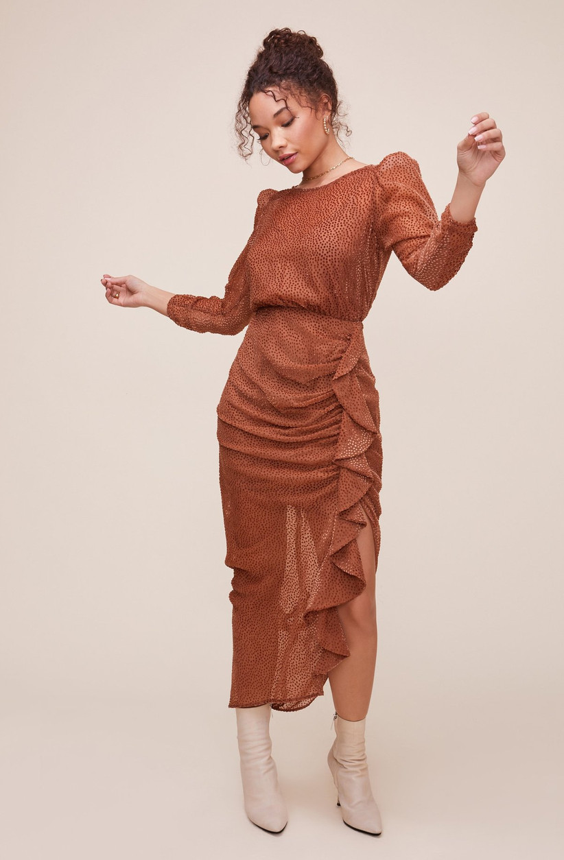 rust orange engagement party dress with bodycon silhouette and ruffled skirt with slit on side