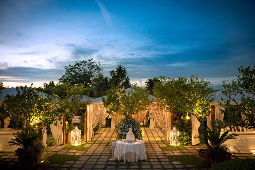outdoor wedding reception at italy wedding venue with twinkle lights in trees and draped canopy tents