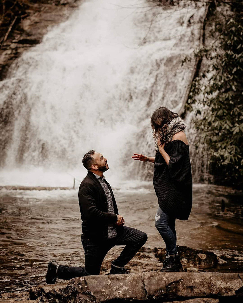 proposal in front of waterfall