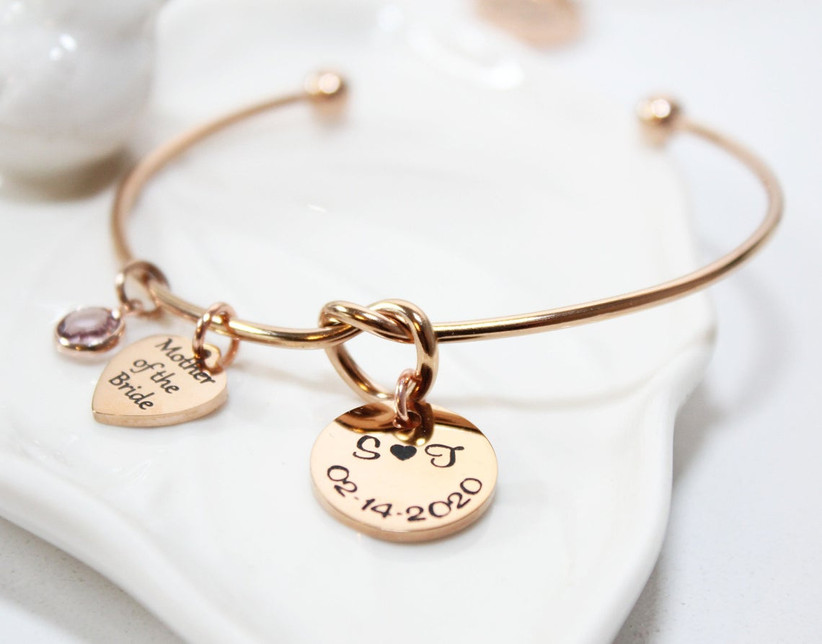 Rose gold bangle with mother of the bride charm and knot detail