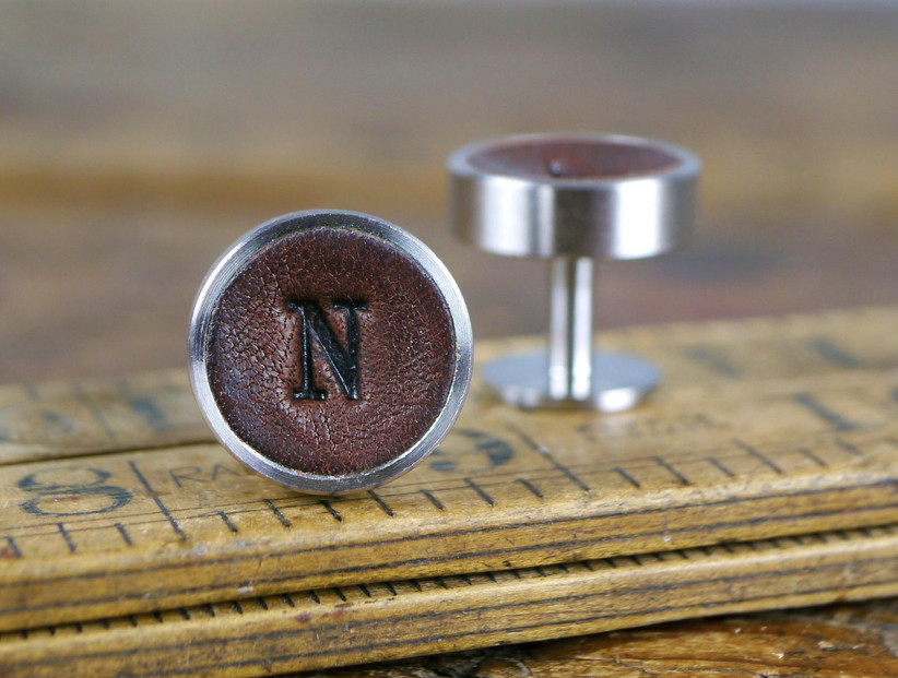 Dark brown leather cuff links with N initial