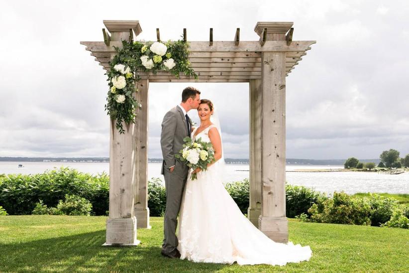 couple at outdoor wedding pergola
