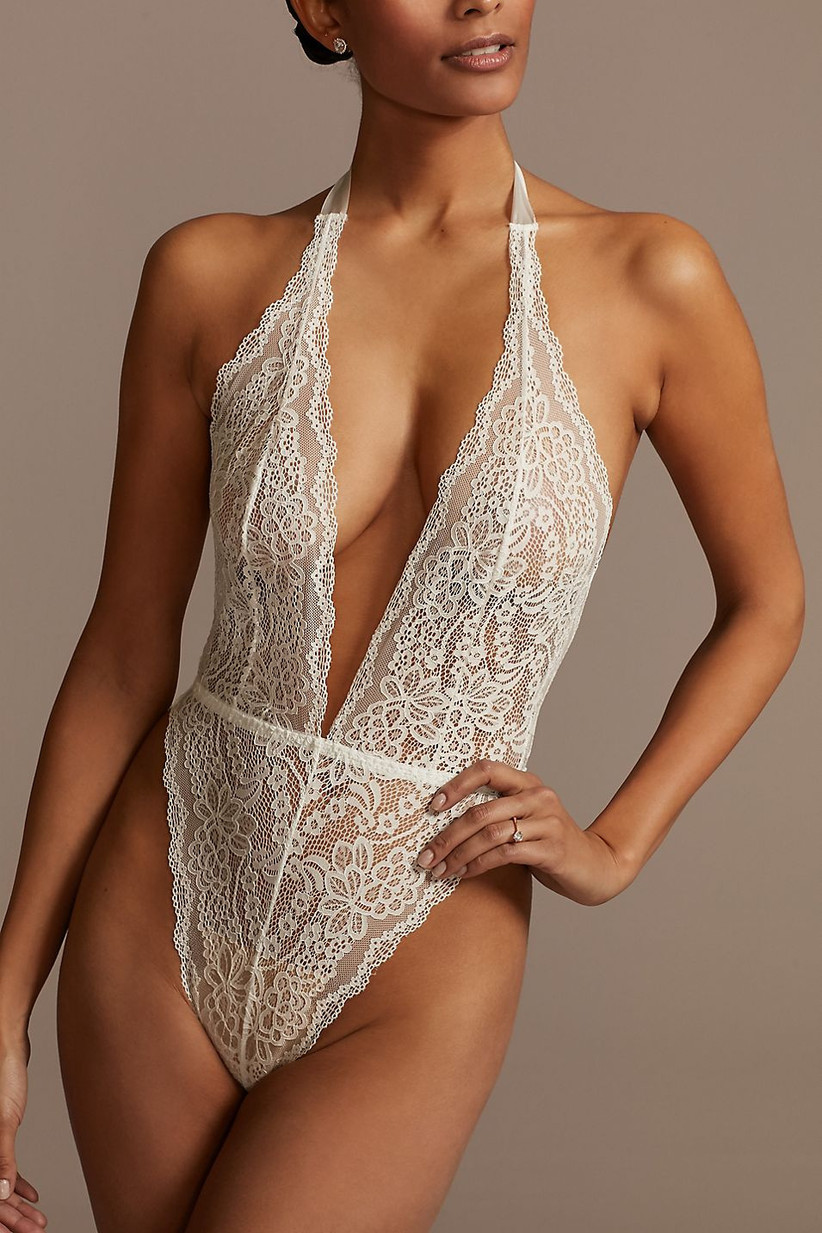 White lace bodysuit with plunging neckline and low back