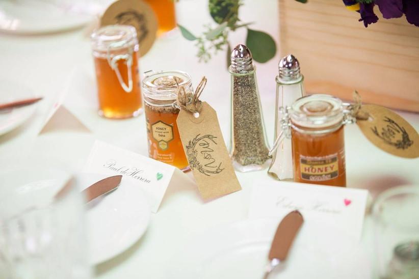 mini jars of honey displayed at place settings
