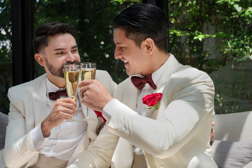 Gay newlywed couple toasting with champagne