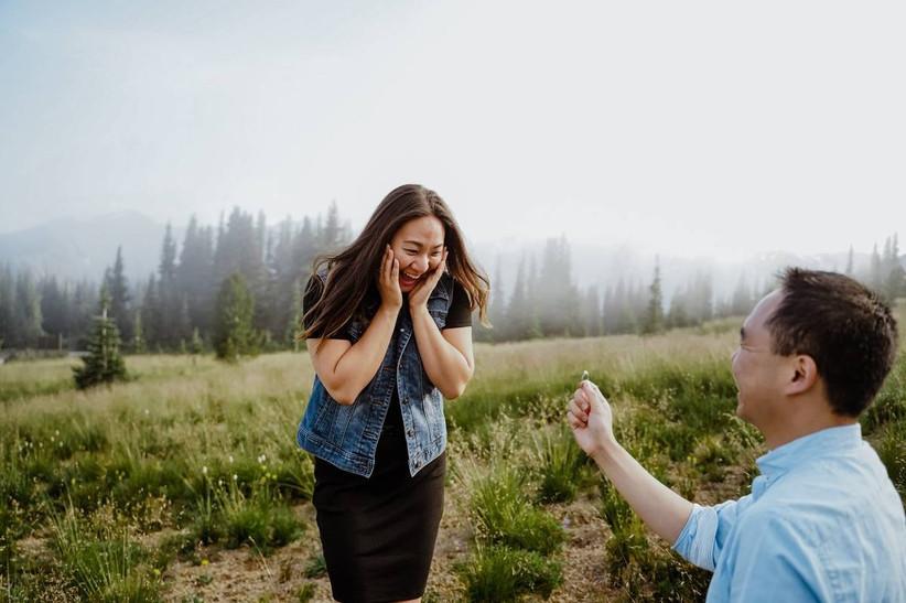 man proposing to surprised woman