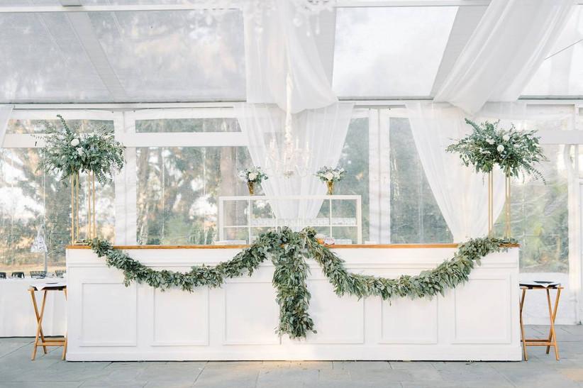 custom wedding bar decorated with eucalyptus greenery garland