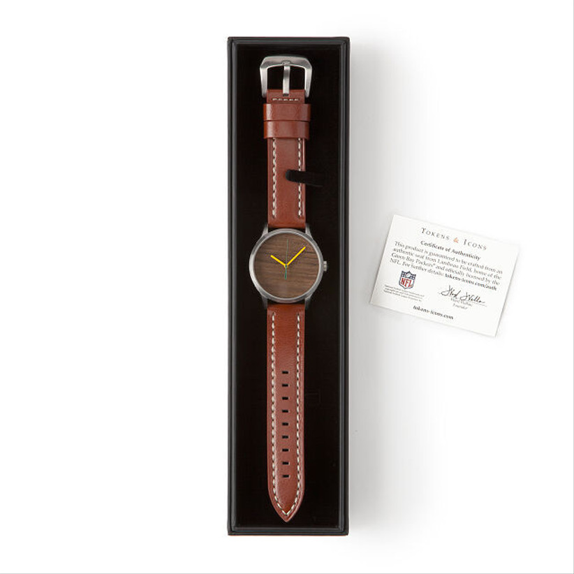 watch with brown leather strap in black case