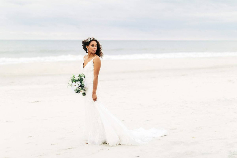 black bride with natural curly hair accessorized with silver beaded headband