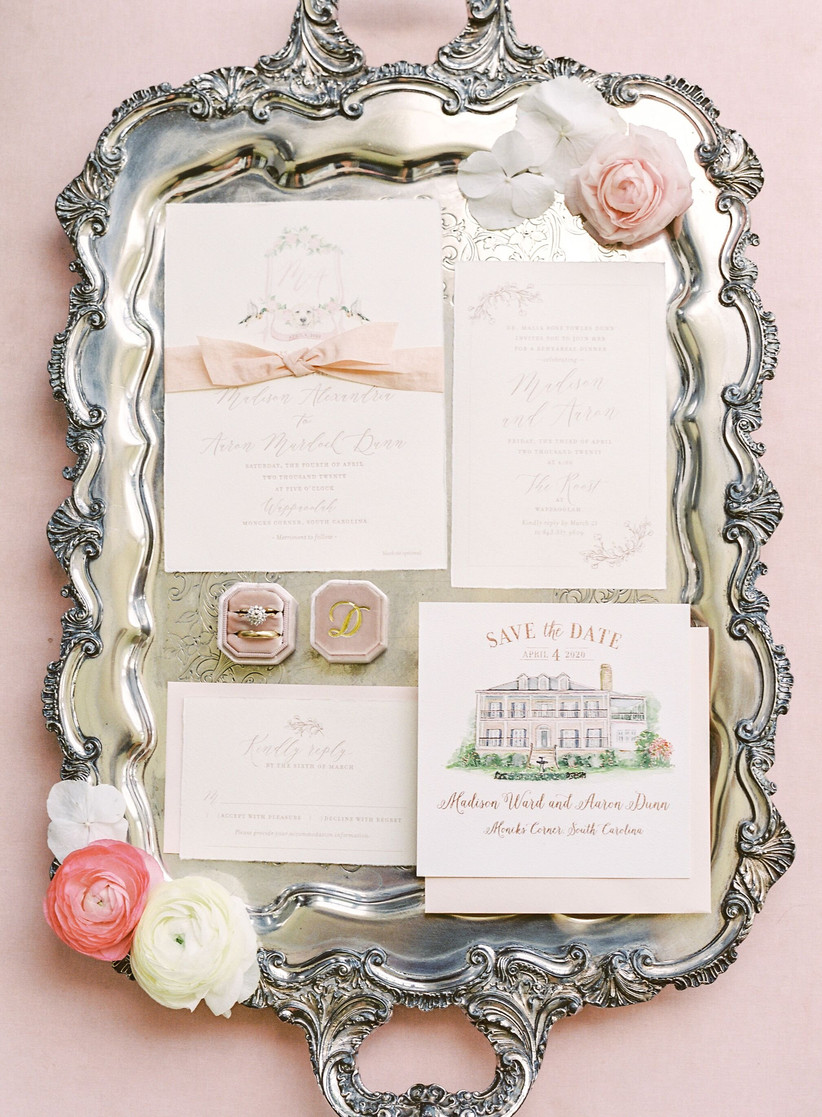 formal wedding invitation suite with watercolor illustrations of dog and venue on a silver tray
