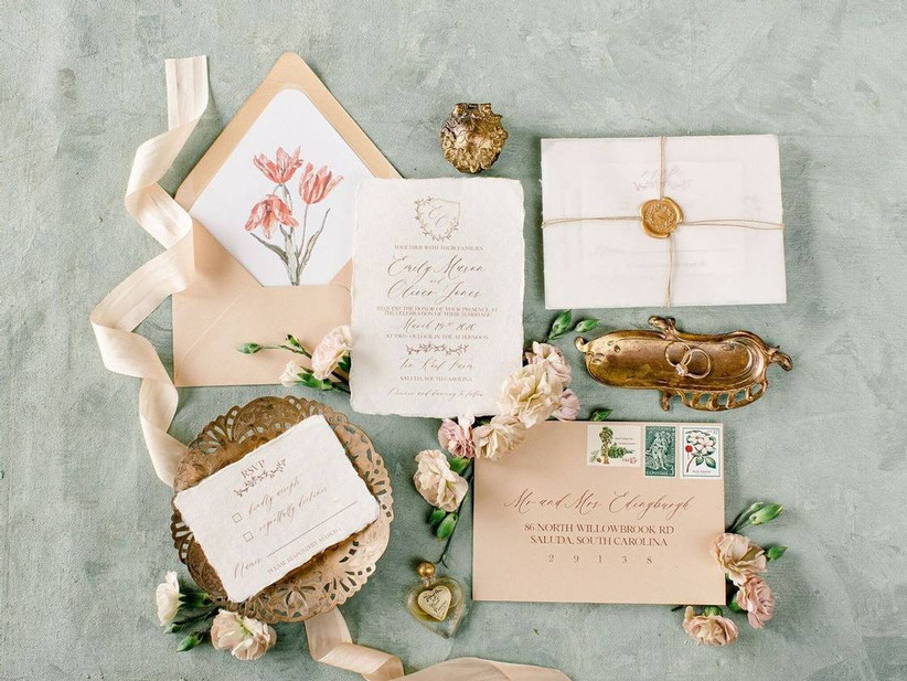 vintage wedding theme invitations with calligraphy and gold wax seal