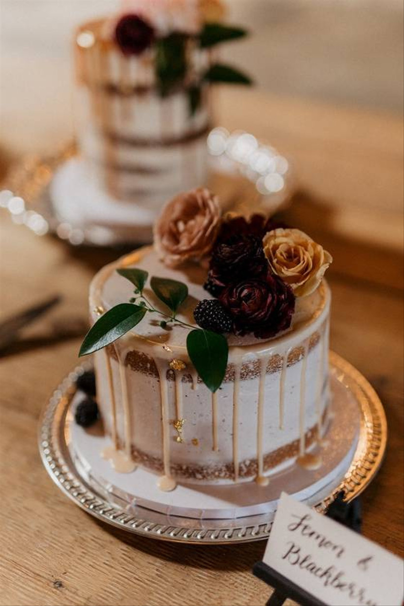 one-tier wedding cake decorated with drip icing and fresh blackberries on top