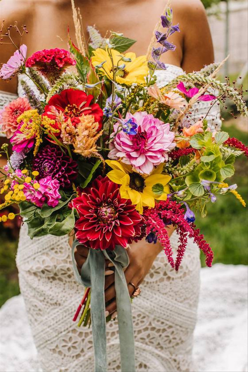 bride holding farm-to-table summer wedding bouquet with wildflowers
