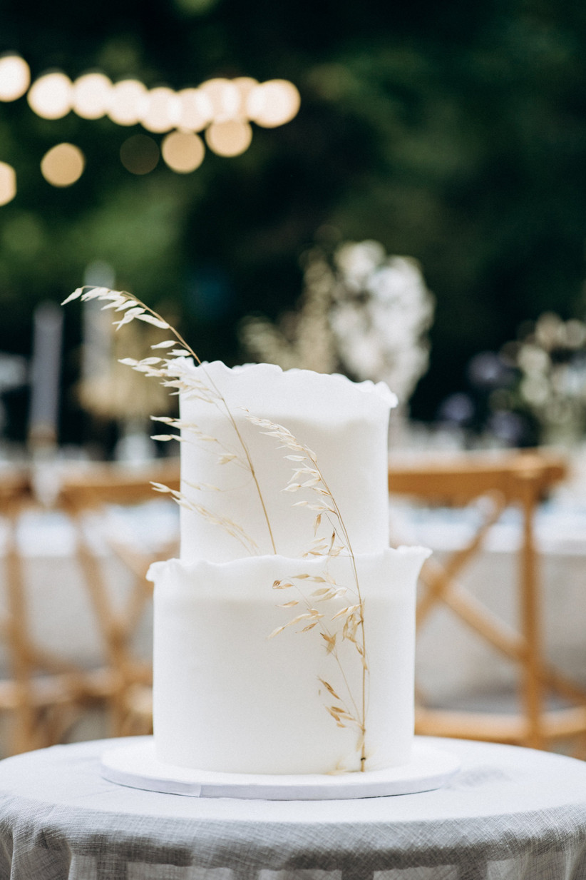 white fondant cake with dried sea oat branch