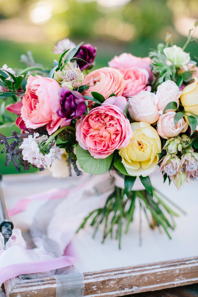 summer wedding bouquet with pink and yellow garden roses