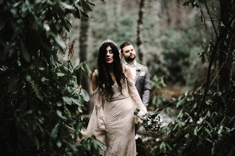 halloween themed wedding idea goth bride wearing lace gown with crystal tiara